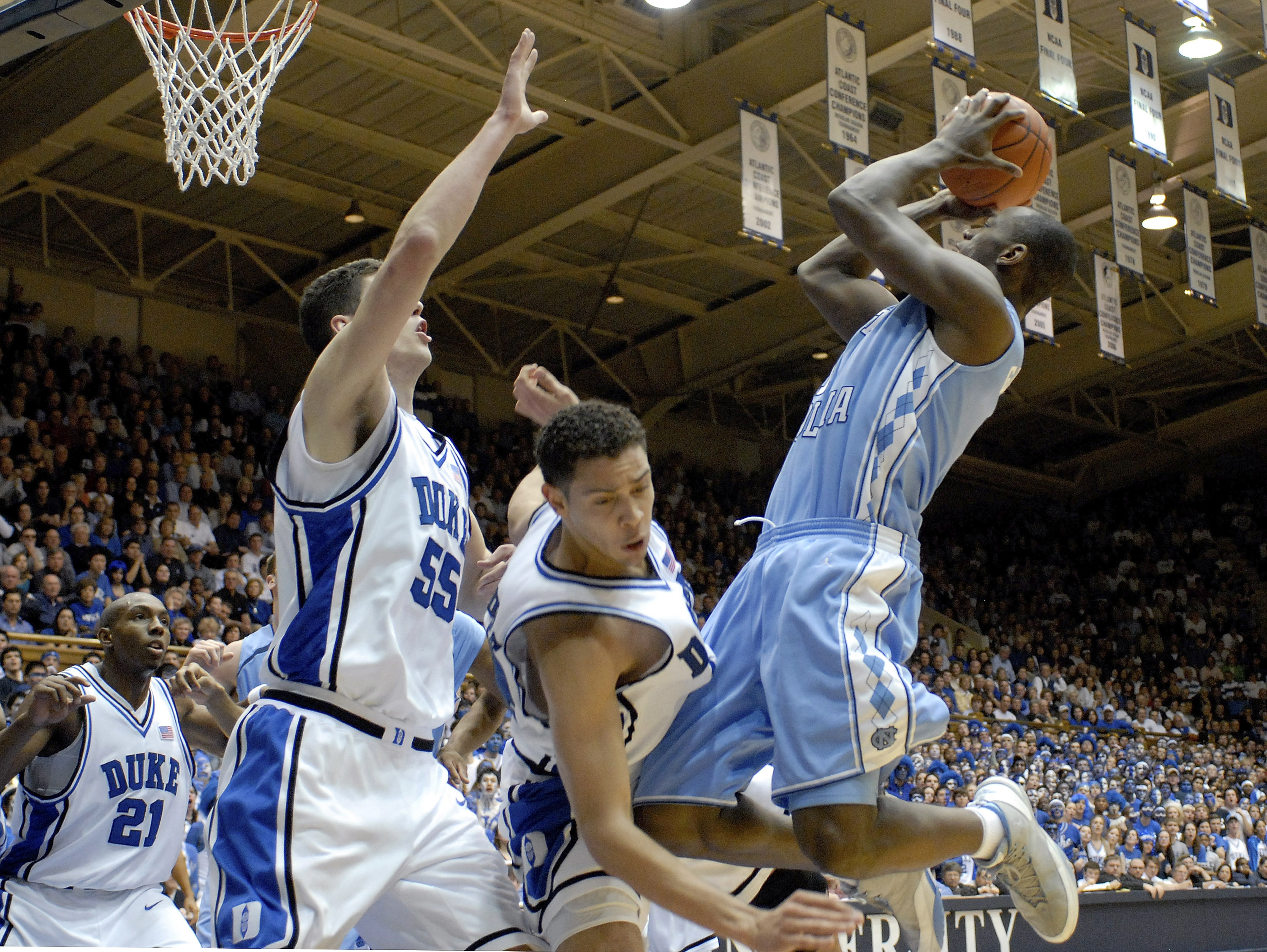 DURHAM, NC - FEBRUARY 07:  David McClure #14 of the Duke University Blue Devils fouls Marcus Ginyard #1 of the North Carolina Tar Heels during their game on February 7, 2007 at Cameron Indoor Stadium in Durham, North Carolina.  (Photo by Grant Halverson/Getty Images)